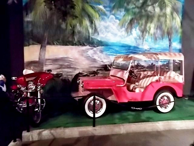 """This 1960 CJ-5 Surrey Edition Jeep is similar to the one that used in Elvis's """"My Blue Hawaii"""" film. Elvis kept if for several years. This optional package was actually offered by Jeep. The Harley Davidson was also one of Elvis's motorcycles."""