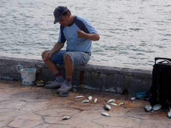 Fisherman Preparing to Fish